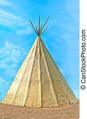 The Classic native Indian tee-pee on blue sky background