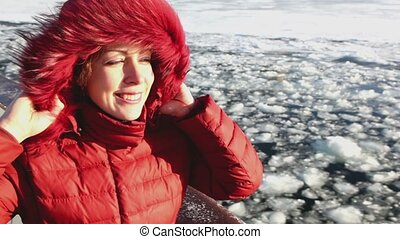 Beautiful woman smile and stand on board at winter