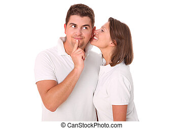 Little secret - A picture of a young woman whispering to her...