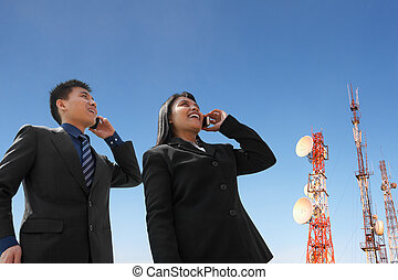 Asian business people on phone and antenna - Asian business...