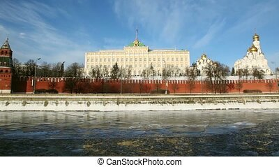 Embankment and red brick walls of Moscow Kremlin and Ivan Great Bell Tower at winter