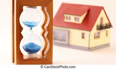 Toy house and hourglass isolated