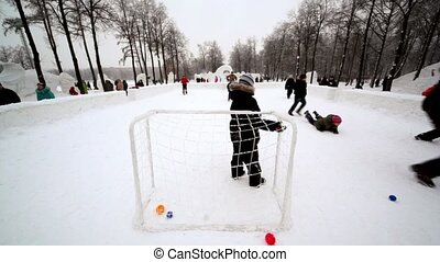 kids play football in park at winter day - Several kids play...