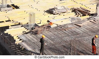 Lot of planks lies on building place, camera move downward...