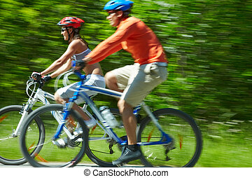 Cyclists in motion - Image in motion of two bicyclists...