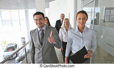 Success - Group of business people walking down the...