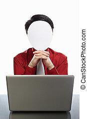 Faceless businessman and laptop