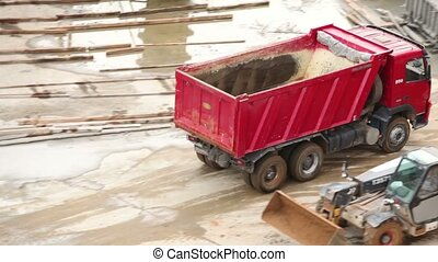 Empty tipper truck leaving from construction site