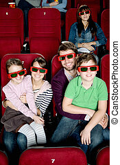 Happy family watching a movie - Happy family with two...