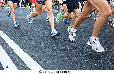 People running in city marathon on street - People running...