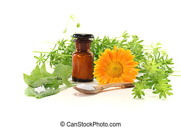 Homeopathy with globules, an apothecary jar, natural herbs...