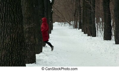 Man catches up with woman among trees at park lane at winter