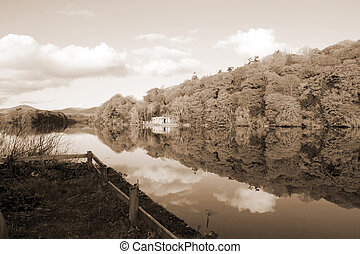 quay and boat house beside the river blackwater reflections...