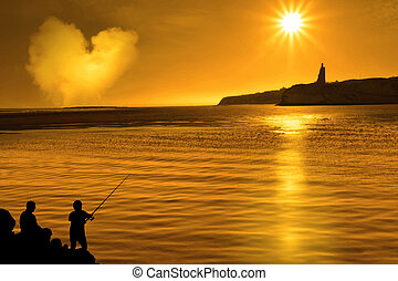 silhouette of father and son loving fishing in Ireland - a...