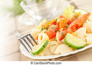 Pasta with vegetables on a plate