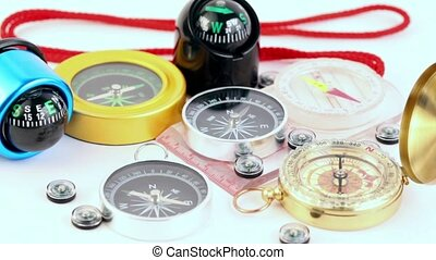 Fifteen different multi-colored compasses - golden vintage,...