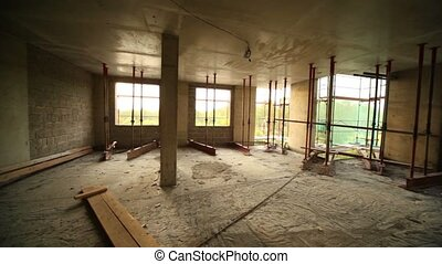 Panorama of unfinished room at construction site, trees...
