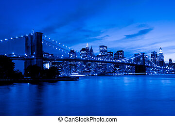 Brooklyn Bridge and Manhattan at sunset, New York, blue tone