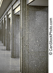 columns coated with gray granite - Many of columns coated...