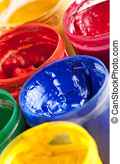 Colourful paints and paintbrushes - Overhead view of...