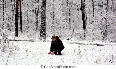 Woman walk closer in woods where all covered with snow
