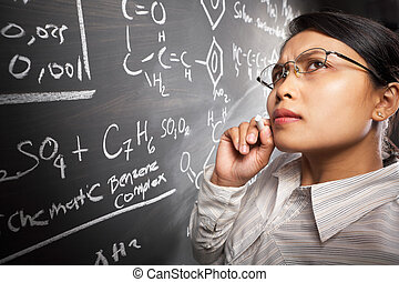 Female student working on equation