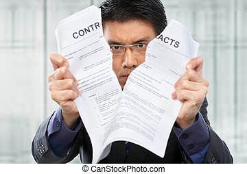 Tearing up the contacts - Chinese businessman tearing up the...
