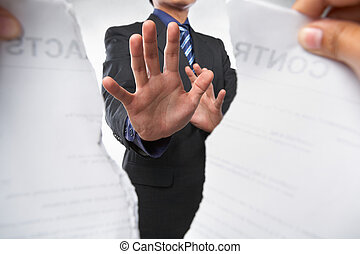 Trying to prevent ripping the contract - Businessman trying...