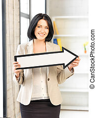 businesswoman with direction arrow sign - picture of...