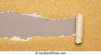 Torn gold paper background with texture and copy space for your text