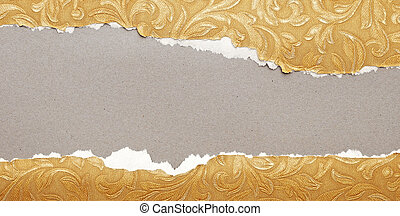 Torn paper - golden paper ripped apart showing underlying...