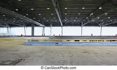 Panorama of spacious empty floor of building with included...