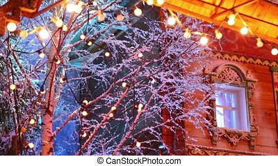 Garland on branches of birch and under roof - Garland on...