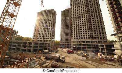 Panorama of construction site, few unfinished tall...