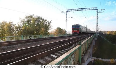 Train passes by on railway bridge