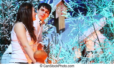 couple stands and talks on balcony at home in forest - cute...