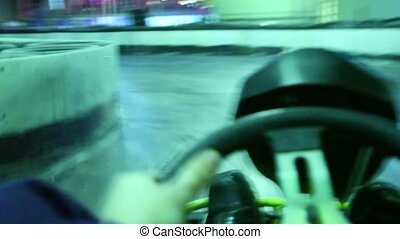Driving on race track for karting, first-person view