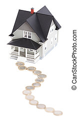 Coins in front of house architectural model, isolated