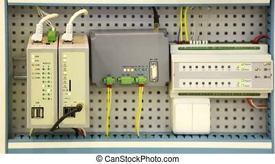 panel of devices with sockets and blinking bulbs close up