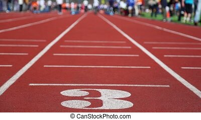Running track number three with special red cover for...