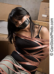 Woman being kidnapped - A young woman tied-up muted in old...