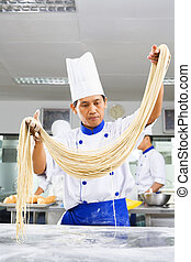 Chef making noodle in the kitchen of cooking school ***PS :...