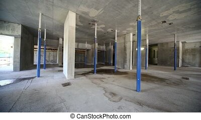 Panorama of unfinished room at construction site, is shown...