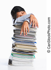 Woman tired behind pile of paper