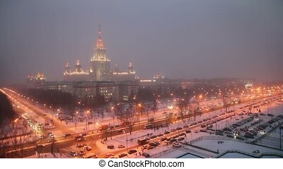 Main building of Moscow State University at winter night in...