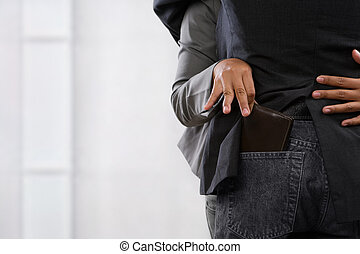 Pickpocket the wallet - female hand picpocketing wallet from...