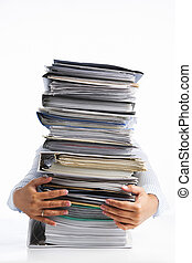 Pile of workload - Female hands holding pile of paperworks,...
