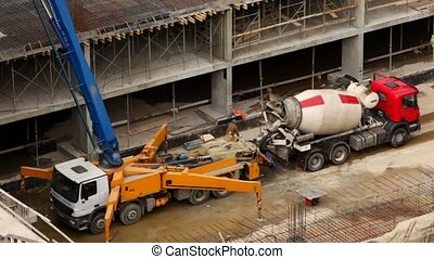 car-crane and car-concrete mixer on building site near to...