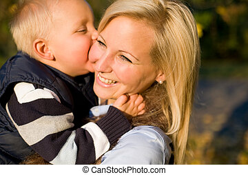 Family love - Family love, young boy kissing his happy mom