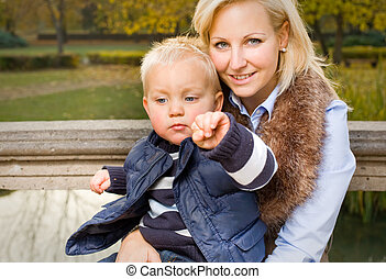 Attractive young mom and son portrait. - Attractive young...